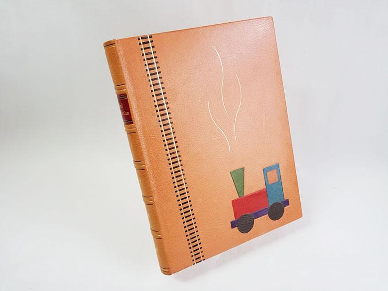Bibliophiler Einband–Modelleisenbahn Front